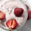 Strawberry yogut with slices of fresh strawberries — Stock Photo