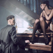 Sexy couple in an intimate situation with piano — Photo