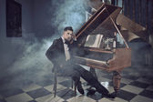 Elegant young man with piano — Stock Photo