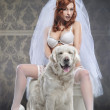 Red beautiful luxury woman in underwear with white dog — Stock Photo