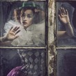 A lonely pierrot woman behind the glass — Stock Photo #10643108