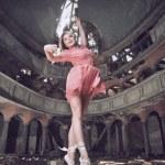 Modern style dancer posing on church — Stock Photo
