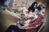 Naked woman and a pig's snout will be eaten by a handsome man — Stock Photo