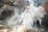 Beautiful angel woman in theatre — Stock Photo