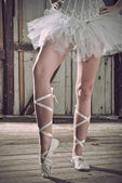 Beauty legs of ballerina standing in pointes — Stock Photo