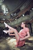 Ballet dancer posing on church — Stock Photo