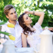Sexy couple in garden — Stock Photo