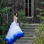Beauty brunette wearing wedding dress — Stock Photo