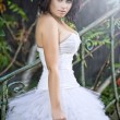 Cute woman wearing wedding dress — Stock Photo