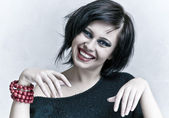 Smiling woman portrait with white teeth and red lipstick — Stock Photo