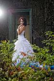 Young woman wearing wedding blue dress — Stock Photo