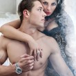 Sexy couple in romantic pose — Stock Photo
