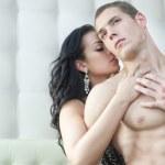 Sexy couple in romantic pose — Stock Photo