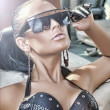 Portrait of fashionable lady wearing sunglasses — ストック写真
