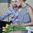 Handsome couple in fashionable room — Stock Photo