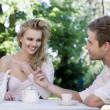Young couple enjoying lunch in the garden — Stock Photo #9943931