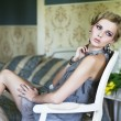 Blonde beauty in a vintage room — Stock Photo