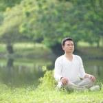 Asian Man Meditating — Stock Photo #8279098