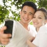 Asian Couple Taking Photographs — Stock Photo