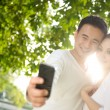 Asian Couple Taking Photographs — Stock Photo #8279109