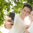 Royalty-Free Stock Photo: Asian Couple Taking Photographs