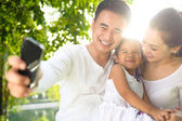 Asian Family Taking Photographs — Stock Photo