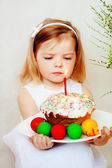Girl with easter eggs and easter cake — Stock Photo