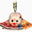 Royalty-Free Stock Photo: Piggy bank and money