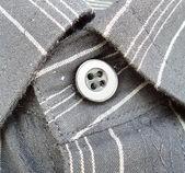 Collare con pulsante su sfondo bianco — Foto Stock