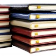 Stacks of colorful leather note books — Stock Photo