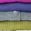 Colorful knitted sweaters - Stock Photo