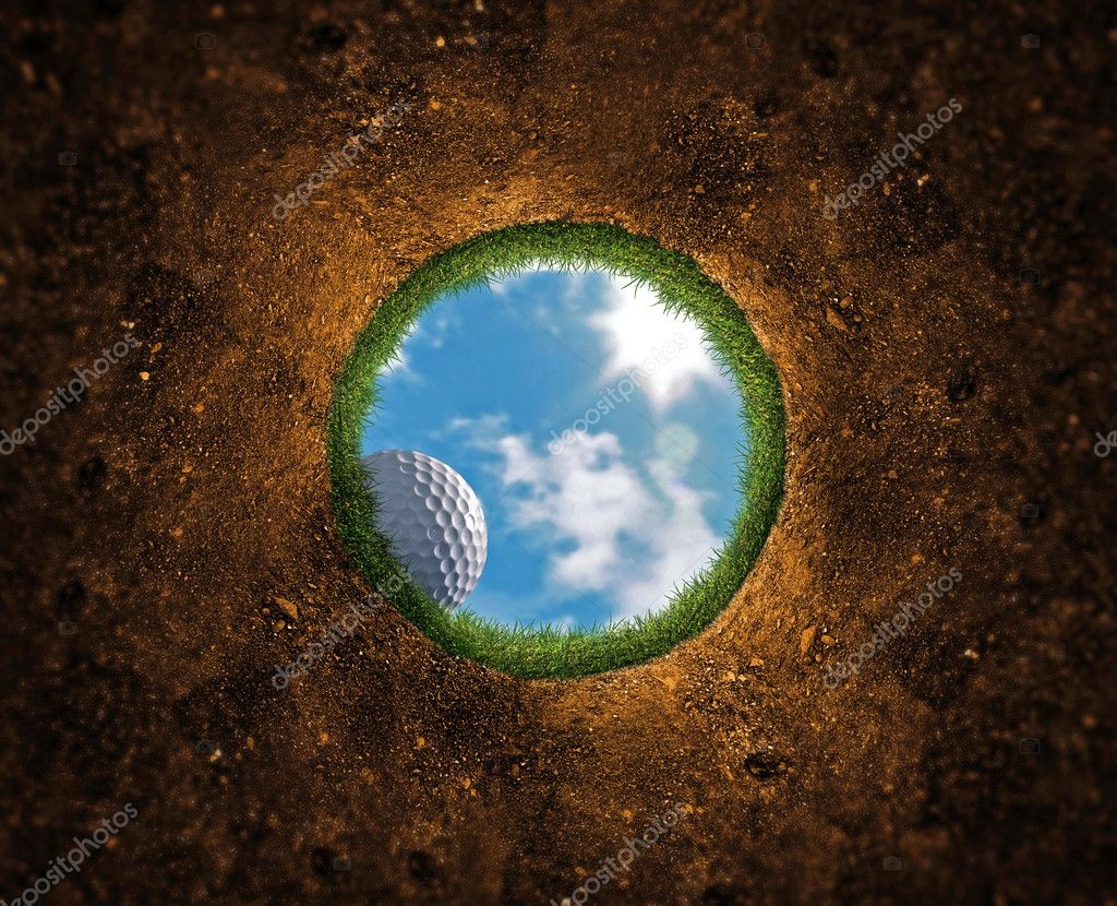 Golf ball falling over the edge into the hole — Стоковая фотография #8536308