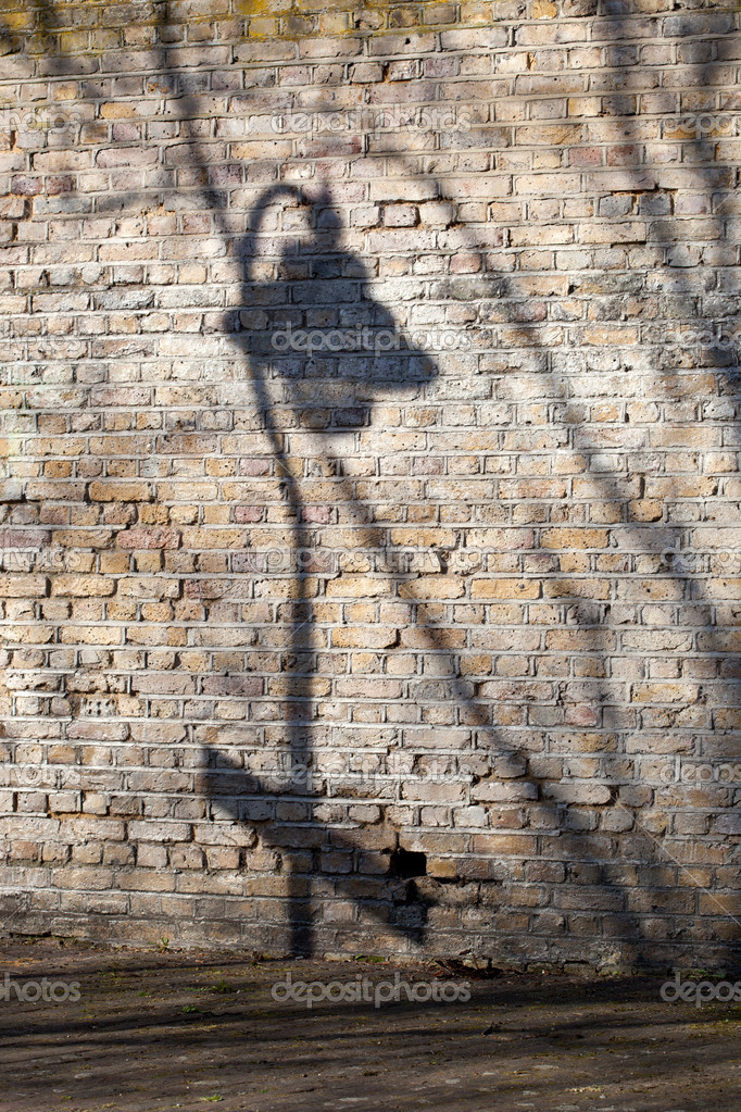Shade of the old-time torch on brick wall — Stock Photo #10173563