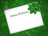 Birthday card with green ribbon on a green background — Stock Photo