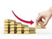 Diminuer le graphique à barres faite de barres d'or — Photo