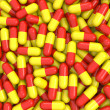 Red and yellow pills background — Foto Stock