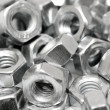 Stock Photo: Assorted screw nuts background