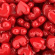 Stock Photo: Red shiny hearts valentine background