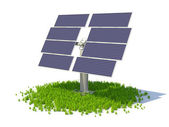 Solar panel standing on a grass forming circle — Stock Photo