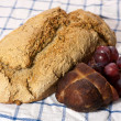 Foto Stock: Fresh organic bread with cold meat and grapes