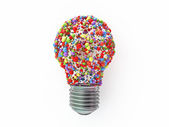 Bulb shape made from colored spheres — Stock Photo