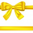 Golden ribbons with bow on white — Stock Vector