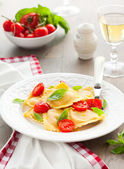 Ravioli with tomatoes and basil — Stock Photo