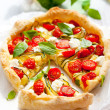 Quiche with tomato and zucchini - Stock Photo