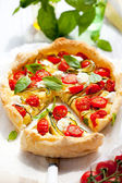 Quiche with tomato and zucchini — Stock Photo