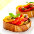 Bruschetta with bell pepper salad - ストック写真