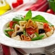 Heart-shaped pasta with vegetables — Stock Photo