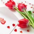 Red hearts ,letter and tulips — Stock Photo