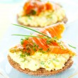 Toast with scrambled eggs,salmon and chives — Stock Photo