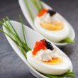 Eggs with caviar - Stock Photo